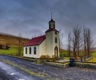 Icelandic Church with street and trees Ringroad Iceland. Photo taken in Iceland near Rekjavik in November Stock Photography