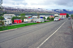 Icelandic city street. AKUREYRI, ICELAND - JUNE 4: Cars on the typical street of Akureyri downtown on June 4, 2013. Akureyri is the second largest city of Stock Photo