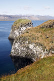 Icelandic cliffs. Beautiful cliffs and basalt rocks in Arnarstrapi - picturesque town on Snaefellsnes penisula in western Iceland. View on Atlantic Ocean Royalty Free Stock Photography