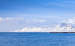 Icelandic coastal landscape with snowy mountains Stock Photography