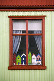 Icelandic cottage with Troll Houses. An Icelandic cottage with Troll Houses in the window. Seydisfjordur in the west of Iceland. A troll is a mythical being Royalty Free Stock Images