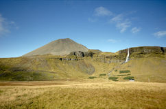 Icelandic countryside. Remote icelandic farm with waterfall Stock Photo