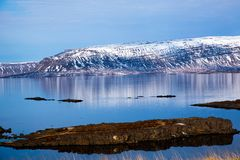 Icelandic fjord reflected in the water stock image