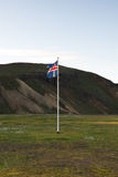 Icelandic flag and green hills near Landmannalaugar area, Icelan Stock Image