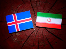 Icelandic flag with Iranian flag on a tree stump isolated Stock Photography
