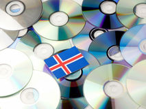 Icelandic flag on top of CD and DVD pile isolated on white. Icelandic flag on top of CD and DVD pile isolated Stock Photos