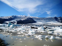 Icelandic Glacial Lake. Fjallsárlón is a glacier lake at the south end of Vatnajökull glacier (Iceland). Some icebergs are drifting by on its surface stock photos