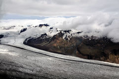Icelandic glacier and mountains partly hidden in clouds. View from Kristinartindar mountain in Skaftafell national park on highest icelandic mountains and Royalty Free Stock Photo