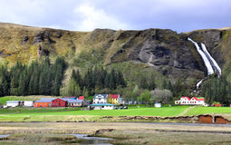 Icelandic houses and waterfall Stock Photography