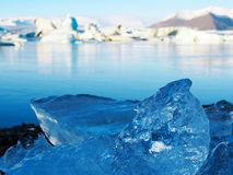 Icelandic ice. Clear water turns to be ice in enormous glacier lagoon Royalty Free Stock Photo