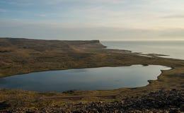 Icelandic lake rising above Atlantic ocean Stock Photos