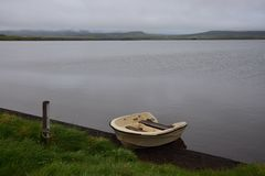 Icelandic landscape with a boat at lake Svinavatn stock image