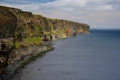 Icelandic landscape. Colorful cliffs on the west coast of peninsula Skagi. stock images