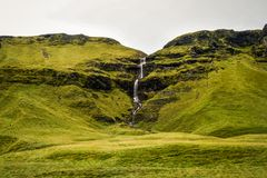 Icelandic landscape, endless spaces of greenery, mountains and w Royalty Free Stock Photo