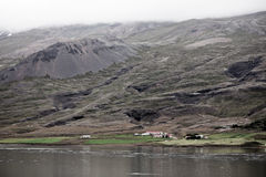 Icelandic Landscape: Farm in Foggy Mountains Stock Photography
