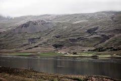 Icelandic Landscape: Farm House in Foggy Mountains Stock Photos