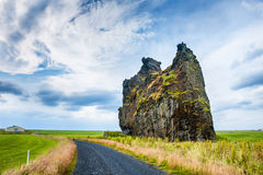 Icelandic landscape with fields and cliffs. Stock Photos