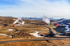 Icelandic landscape with geothermal power plant station and pipe. S in the valley, Myvatn lake surroundings, Iceland Royalty Free Stock Photo