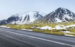 Icelandic landscape with highway and mountains Stock Images