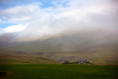 Icelandic Landscape: Lonely House in Foggy Mountains Stock Images