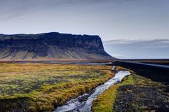 Icelandic Landscape with mountains and river with grass and stre Stock Image