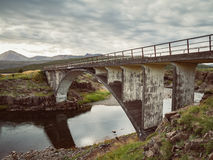 Icelandic landscape with an old bridge Stock Photo