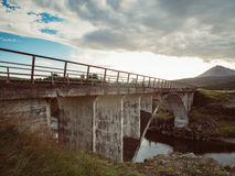 Icelandic landscape with an old bridge Royalty Free Stock Photo