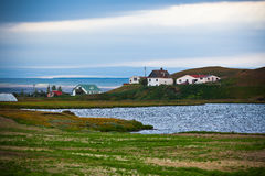 Icelandic Landscape with Small Location at Fjord Coastline Royalty Free Stock Images