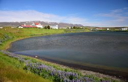 Icelandic landscape, the small town Blönduos, with the ocean in the front and mountains in the background. stock images