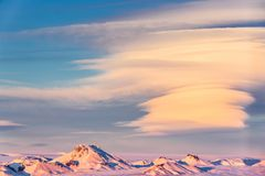 Icelandic landscape with snow-capped mountain peaks. And spectacular cloud formations, near Gullfoss, at sunset Royalty Free Stock Image
