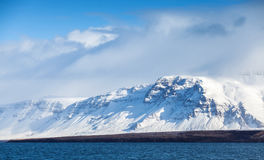 Icelandic landscape with snowy mountains and sky Stock Photo