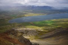 Icelandic landscape. View from the top of the Svinadalsfjall to the lake Svinavatn. A mountain slide below stock photography