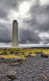 Icelandic lighthouse against a stormy sky Royalty Free Stock Photos