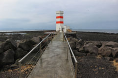 Icelandic lighthouse by the sea Stock Images