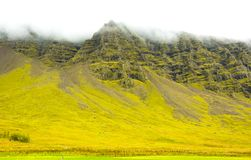Icelandic moss and volcanic rocks mountain / Iceland Royalty Free Stock Images
