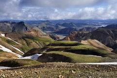 Icelandic mountain landscape on early summer. Icelandic mountain volcanic landscape partly covered by snow nad clouds Royalty Free Stock Image