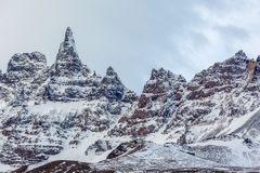 Icelandic mountain peaks covered with snow. A group of Icelandic mountain peaks covered with a thin layer of snow. The peaks look like pointing fingers Royalty Free Stock Image