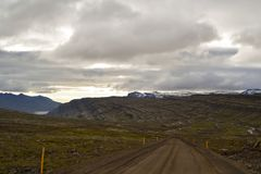Icelandic mountain stones and road. And sky Royalty Free Stock Images
