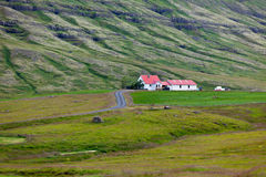 Icelandic Nature Landscape with Mountains and Dwellings Royalty Free Stock Photos