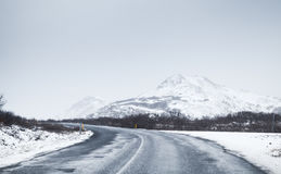 Icelandic road covered with snow, rural landscape Stock Photo