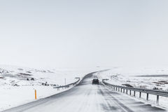 Icelandic road covered with snow, rural winter Stock Photography