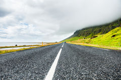 Icelandic road between the ocean and mountains Stock Image