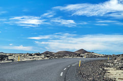 Icelandic road on a sunny day Stock Photos