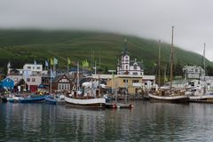 Icelandic Seaport: Boats for fishing and for whale watching tours gather at the port of Husavik. Iceland royalty free stock images
