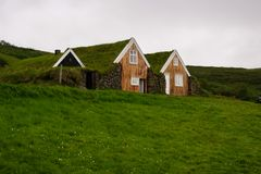 Icelandic traditional house covered with grass, in southern Iceland stock photos