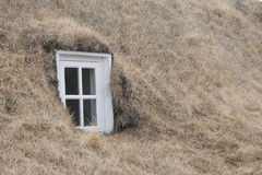 Icelandic turf house window. Turf house window in long valley near Husavik Iceland in 2013 Royalty Free Stock Photos