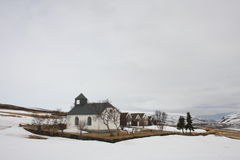 Icelandic church. Church, graveyard and turf houses in a valley in northern Iceland. An old Icelandic farm or farmstead in the winter stock photos
