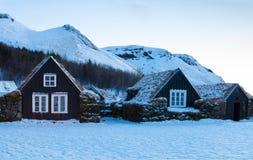 Icelandic turf houses at dawn in winter, Skogar, Iceland. Icelandic turf houses at dawn in winter,  Skogar, Iceland Stock Photography