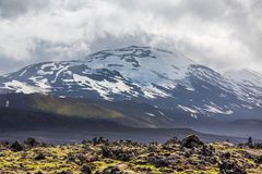 Icelandic volcano with snow and cloudy sky Stock Image