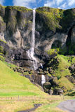 Icelandic Waterfall. Waterfall along the road in the south of Iceland Royalty Free Stock Photography
